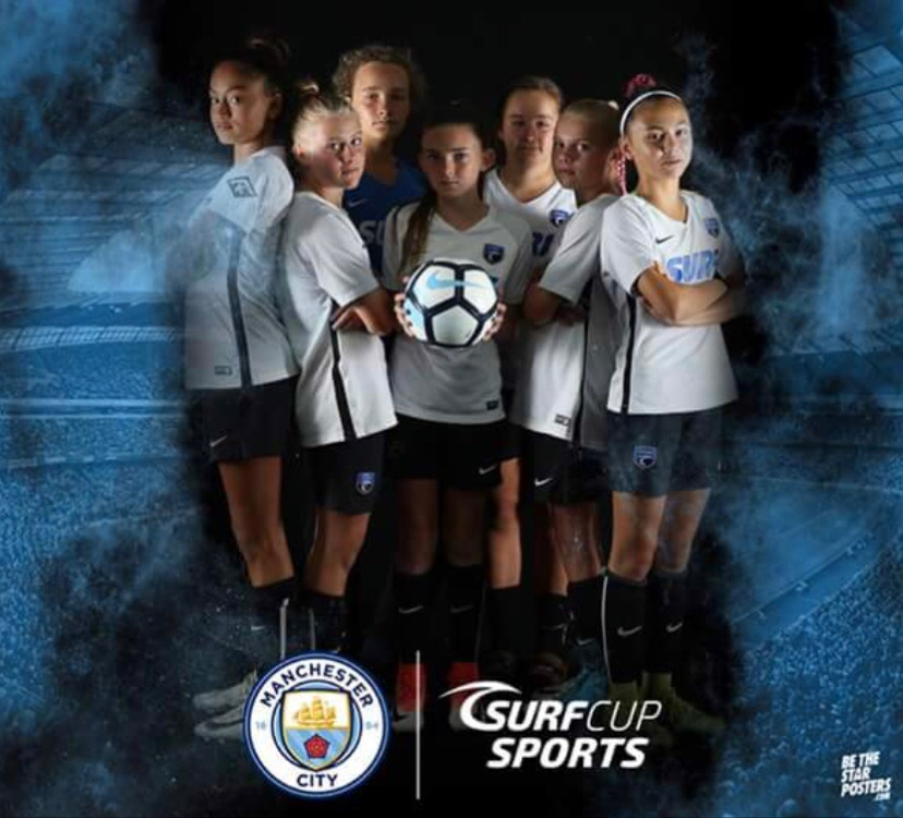 Girls from across the Surf Network posing for the photo booth at Man City Cup